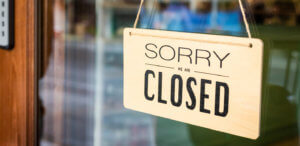 closed business sign to show business interruption insurance