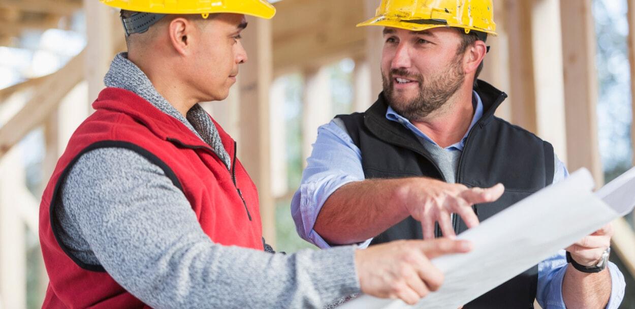 contractors reviewing plans