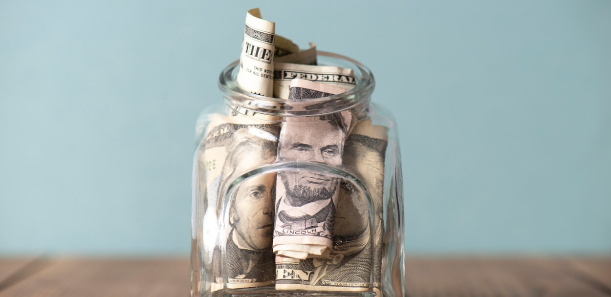 money in a jar to show deductibles vs premiums