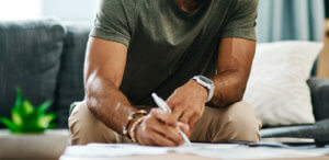 man signing a liability waiver
