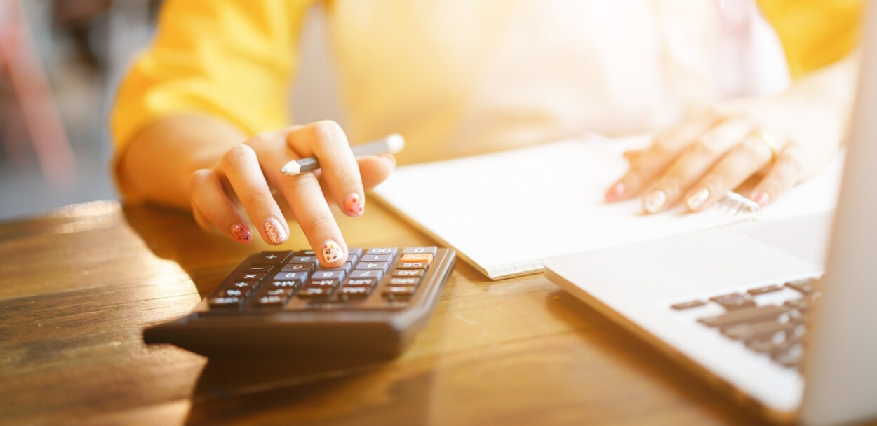 business owner calculating workers comp