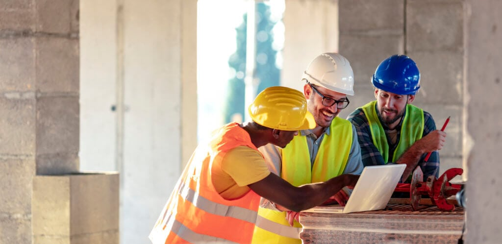 construction workers reviewing plan