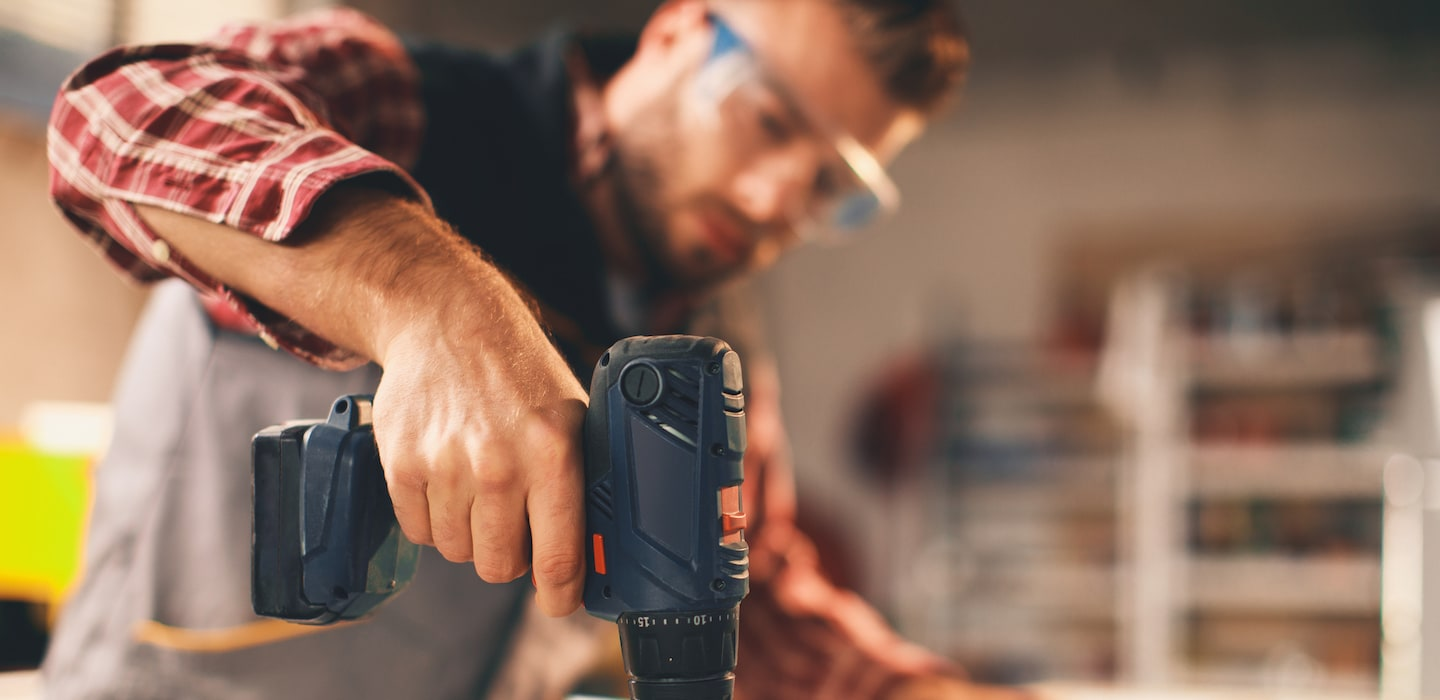 handyman working with a drill