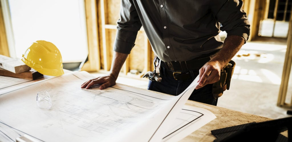 contractor reviewing plans