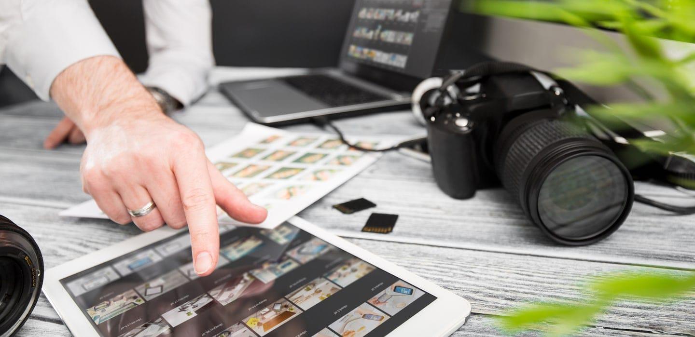 real estate photographer reviewing photos