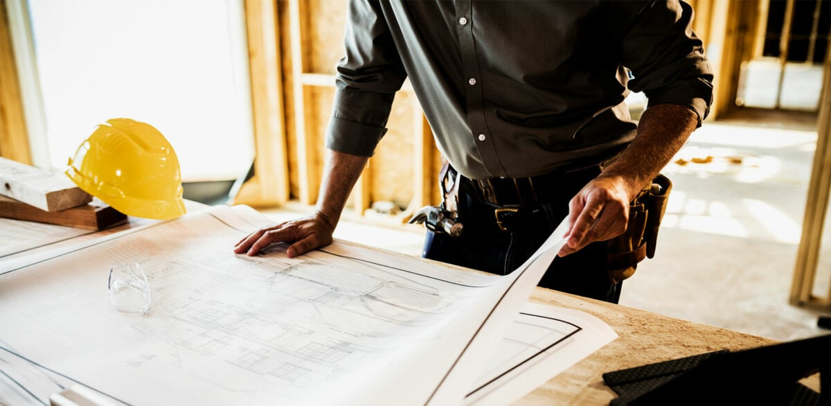 Engineer working on a blueprint