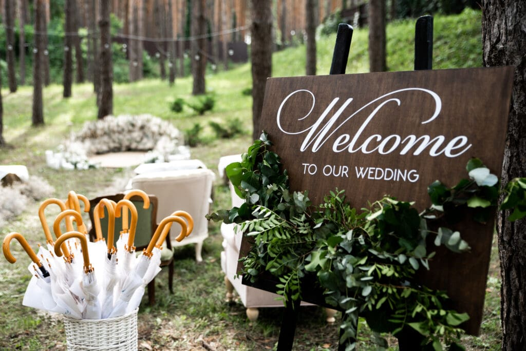 Wooden board and umbrellas for wedding