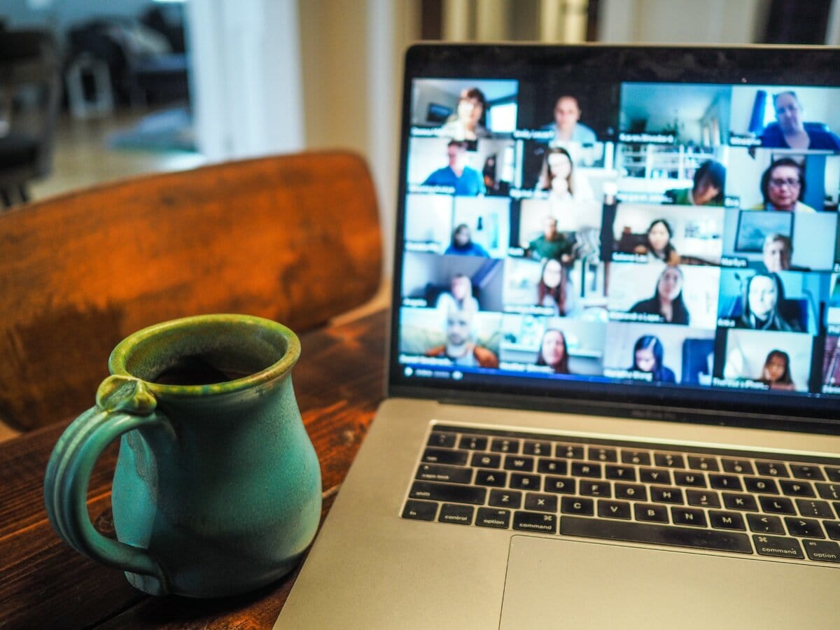 Laptop showing people in an online meeting